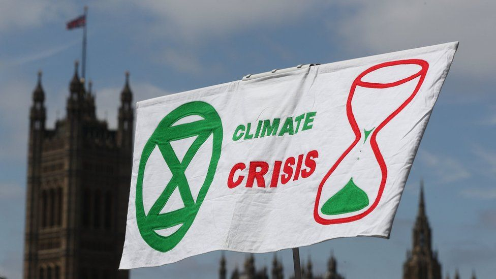Climate change protest 'The Time is Now' descends in Westminster, London